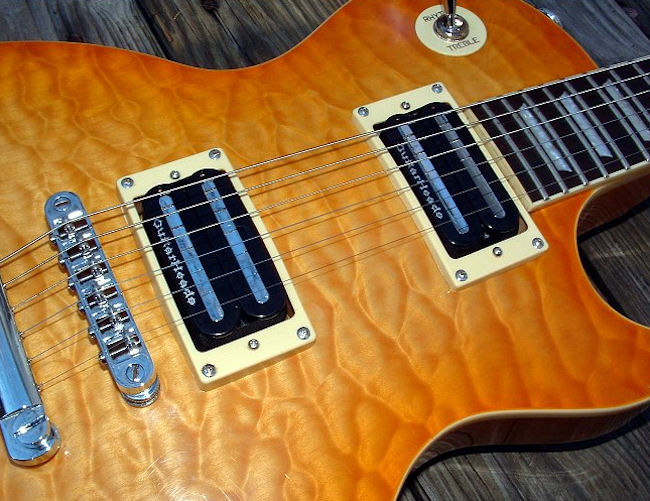 the guitarheads megametal humbucker was designed with the super shredder in  mind  the bar design will accommodate string spacings from 48mm to 54mm,